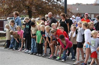 November 12, 2011 - Kids line up to start the 1-mile Kids' Cumulative Marathon outside the Paris Civic Center. Gabby Pack and Hunter Lawrence, representing Paris Elementary School, were the first female and male to cross the finish line.